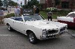 White Classic GTO Convertible <p>Super clean with cragar rims.  When I was a kid this was all I wanted someday in a car.  Still to this day I don't have one yet. </p>